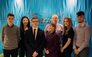 (l-r) Oliver Ginger, Technical Support Apprentice, Elsa Chen, CEO, Jak Mason, Technical Support Apprentice, Shannon Thomas, HR Assistant, Tim Robert, HR Manager, Hannah Jinks, Customer Services Apprentice and Daniel Saxon, Customer Services Apprentice